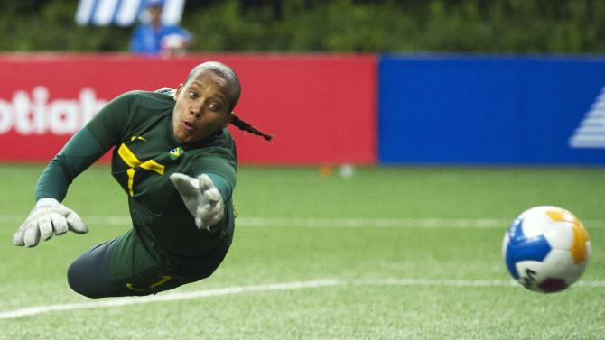 Brazil goalie Barbara Barbosa makes a diving save against Canada during second half of the gold medal women's soccer match at the Pan American Games in Guadalajara, Mexico on Thursday, Oct. 27, 2011. (AP Photo/The Canadian Press, Nathan Denette)