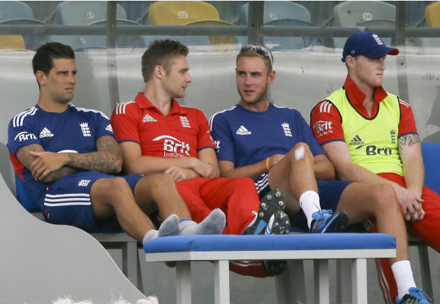 England's Stuart Broad, second from right, sits at the dog out during the second T20 International cricket match against West Indies at the Kensington Oval in Bridgetown, Barbados, Tuesday, March