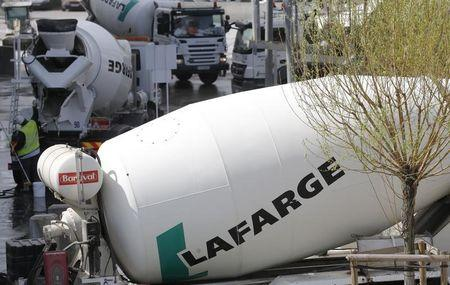 Concrete mixing trucks are seen at Lafarge concrete production plant in Pantin