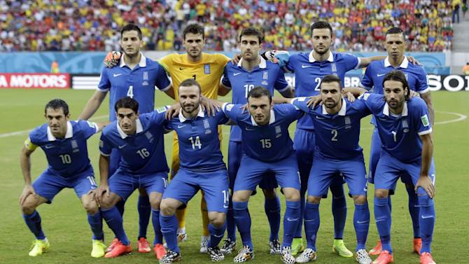 The Greek team pose for a group photo before the World Cup round of 16 soccer match between Costa Rica and Greece at the Arena Pernambuco in Recife, Brazil, Sunday, June 29, 2014
