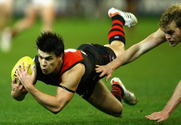 Angus Monfries of the Bombers dives for a mark during the round 10 AFL match between the Essendon Bombers and the Melbourne Demons at the Melbourne Cricket Ground on June 2, 2012 in Melbourne, Australia. (Photo by Robert Prezioso/Getty Images)