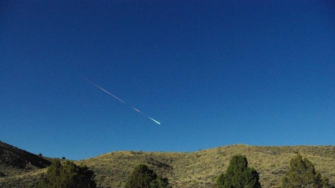 This image provided by NASA's Jet Propulsion Laboratory shows a meteor over Reno Nevada Sunday April 22, 2012. The former space rock-turned-flaming-meteor entered Earth's atmosphere around 8 a.m. PDT. Reports of the fireball have come in from as far north as Sacramento, Calif. and as far east as North Las Vegas, Nev. Bill Cooke of the Meteoroid Environments Office at NASA's Marshall Space Flight Center in Huntsville, Ala., estimates the object was about the size of a minivan, weighed in at around 154,300 pounds (70 metric tons) and at the time of disintegration released energy equivalent to a 5-kiloton explosion. (AP Photo/Lisa Warren, NASA/JPL)