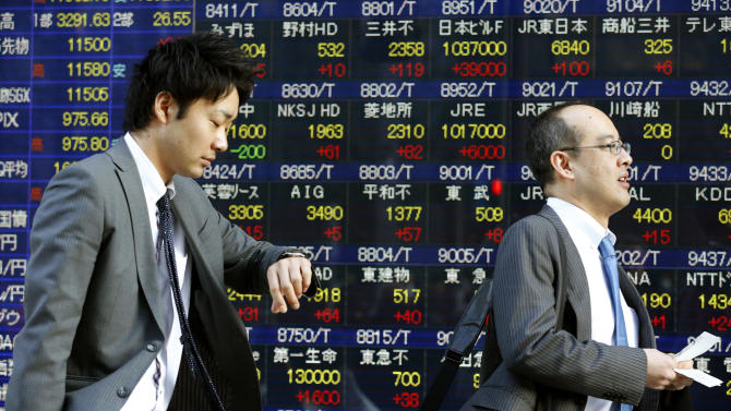 A man looks at his watch while walking in front of an electronic stock indicator in Tokyo, Thursday, Feb. 28, 2013. Asian stock markets rose Thursday as positive economic indicators and the nomination of a pro-stimulus Bank of Japan chief bolstered hopes for faster growth. The Nikkei 225 stock average closed at 11,559.36, up 2.7 percent. (AP Photo/Shizuo Kambayashi)