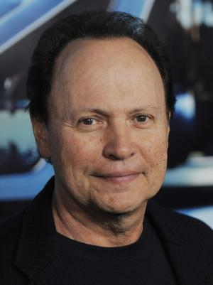 """FILE - In this March 22, 2011 file photo, Billy Crystal arrives at the premiere of the HBO documentary film """"His Way"""" in Los Angeles. Crystal says he is hosting the Academy Awards.  The 63-year-old comedian and Oscar-hosting veteran said Thursday on Twitter that he is """"doing the Oscars so the young woman in the pharmacy will stop asking my name when I pick up my prescriptions.""""    (AP Photo/Chris Pizzello, file)"""