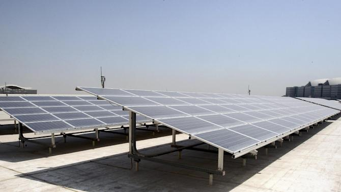 In this Thursday, Sept. 20, 2012 photo, solar panels are seen on the roof of the Qatar National Convention Center (QNCC) in Doha, Qatar. From the sustainably-logged wood used in its construction to the 3,500-square-meters of solar panels on the roof, the building designed by Japanese architect Arata Isozaki is considered one of the most environmentally sound convention centers in the world.Green buildings would seem an oddity in this tiny Gulf nation which has plenty of oil and gas and, according to the International Energy Agency, the highest per capita emissions in the world, closely followed by Gulf neighbors Kuwait, Bahrain and the United Arab Emirates. (AP Photo/Osama Faisal)