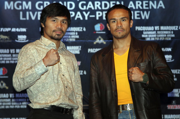 Boxers Juan Manuel Marquez, right, and Manny Pacquiao pose for pictures during a news conference in New York, Wednesday, Sept. 19, 2012. The boxers are promoting their fourth fight, scheduled for Dec. 8, 2012 in Las Vegas. (AP Photo/Seth Wenig)