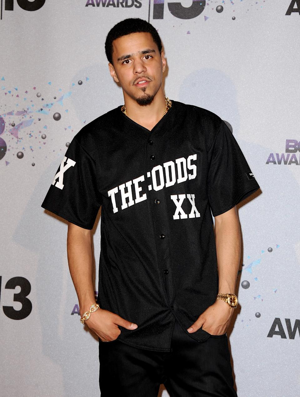 J. Cole poses backstage at the BET Awards at the Nokia Theatre on Sunday, June 30, 2013, in Los Angeles. (Photo by Scott Kirkland/Invision/AP)