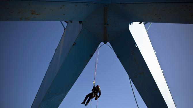 An Israeli fire fighter rappels down a rope during a rescue drill at Ashdod port