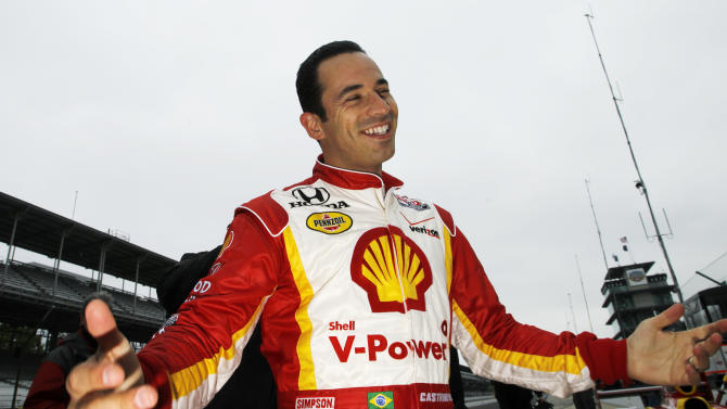 IndyCar driver Helio Castroneves, of Brazil, jokes with his crew after the team practiced pit stops during practice for the Indianapolis 500 at the Indianapolis Motor Speedway in Indianapolis, Tuesday, May 17, 2011. (AP Photo/Darron Cummings)