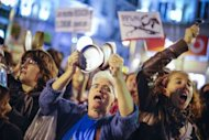 <p>People make noise as they take part in a march to protest against government's austerity reforms and the public payment of bank's debts in Madrid.</p>
