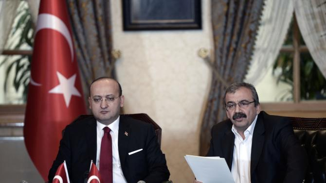 Onder, a lawmaker of the pro-Kurdish HDP party, reads a statement during a meeting with Turkey's Deputy PM Akdogan in Istanbul