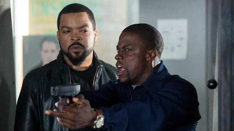 "FILE - This image released by Universal Pictures shows Ice Cube, left, and Kevin Hart in a scene from ""Ride Along."" The PG-13 monster thriller ""I, Frankenstein"" will attempt to capitalize on a football-free weekend and try to unseat box-office leader ""Ride Along,"" the Kevin Hart comedy. (AP Photo/Universal Pictures, Quantrell D. Colbert, File)"