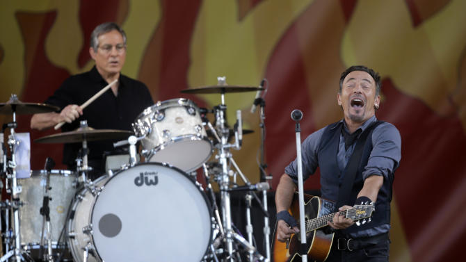 Bruce Springsteen performs with drummer Max Weinstein at the New Orleans Jazz and Heritage Festival in New Orleans, Saturday, May 3, 2014. (AP Photo/Gerald Herbert)