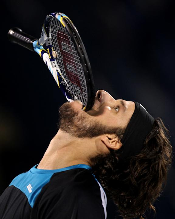 Feliciano Lopez Of Spain Bites AFP/Getty Images