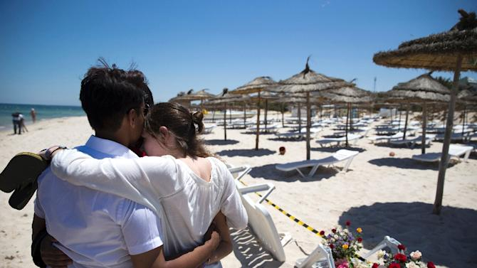Tourists console each other at the site of a shooting attack on the beach in front of the Riu Imperial Marhaba Hotel in Port el Kantaoui, on the outskirts of Sousse south of the capital Tunis, on June 27, 2015