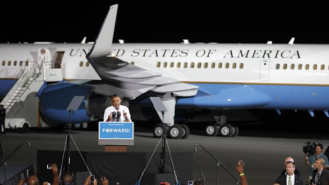 FILE - This Oct. 25, 2012 file photo shows President Barack Obama speaks in front of Air Force One at a campaign event at Burke Lakefront Airport in Cleveland. President Barack Obama's and Mitt Romney's meticulously arranged travel schedules, a crucial element of their final-stretch strategies, could be upended in the last full week before Election Day by a super storm barreling toward some battleground states. (AP Photo/Tony Dejak, File)