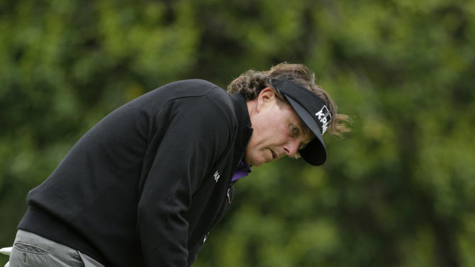 Phil Mickelson putts on the first green during the final round of the Wells Fargo Championship golf tournament at Quail Hollow Club in Charlotte, N.C., Sunday, May 5, 2013. (AP Photo/Chuck Burton)
