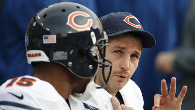 Chicago Bears quarterback Jay Cutler, right, and wide receiver Brandon Marshall (15) take a break on the bench after Cutler threw a touchdown pass to Marshall against the Tennessee Titans in the fourth quarter of an NFL football game on Sunday, Nov. 4, 2012, in Nashville, Tenn. Marshall caught three touchdown passes from Cutler as the Bears beat the Titans 51-20.  (AP Photo/Joe Howell)