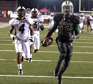 Baylor receiver Tevin Reese, right, scores past Louisiana-Monroe defender Rob'Donovan Lewis, left, in the first half of an NCAA college football game on Friday Sept. 21, 2012, in Monroe, La. (AP Photo/Waco Tribune-Herald, Duane A. Laverty)