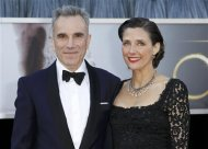 "Daniel Day-Lewis, best actor nominee for his role in the film ""Lincoln"", and his wife Rebecca Miller arrive at the 85th Academy Awards in Hollywood, California February 24, 2013. REUTERS/Lucas Jackson"