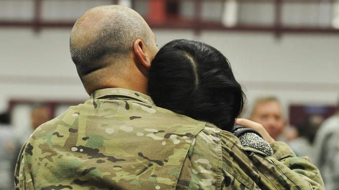 South Carolina Gov. Nikki Haley, right, hugs her husband, Capt. Michael Haley during a deployment ceremony for the South Carolina Army National Guard 3/49 Agribusiness Development Team at McCrady Training Center, Thursday, Jan. 10, 2013, at Ft. Jackson, S.C. The deployment is scheduled for a year including one month of training in Indiana prior to leaving for Afghanistan. (AP Photo/Rainier Ehrhardt)