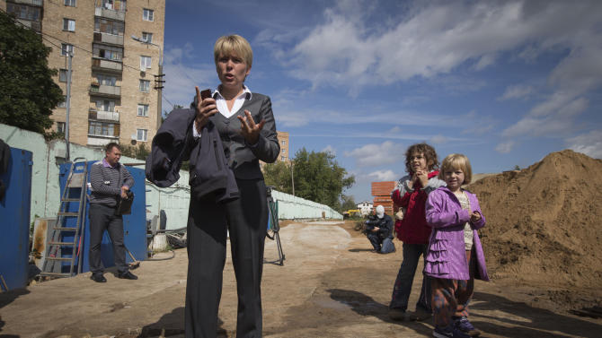 In this Thursday, Aug. 23, 2012 photo, Yevgenia Chirikova speaks to press at at unauthorised construction site in Khimki, outside Moscow. When the young mother of two embarked on her small and private campaign to save a forest in her town just outside Moscow, she had no clue that in order to gain the upper hand in this battle she would need to launch a nationwide campaign, hold a thousand-strong rally and ultimately run for mayor of that town. Environmental activist Yevgeniya Chirikova, a driving force behind a movement to save the forest in Khimki, is now running for mayor of that town which, thanks largely to her efforts, became one of the first battlegrounds of the anti-Kremlin protests. The Khimki vote could prove the first major electoral test for authorities and the opposition since the anti-Putin protests. (AP Photo/Sergey Ponomarev)