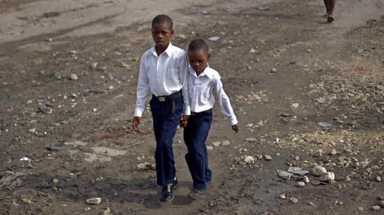Children walk to attend Mass at the Cite Soleil slum in Port-au-Prince, Haiti, Sunday, Aug. 28, 2011. (AP Photo/Ramon Espinosa)