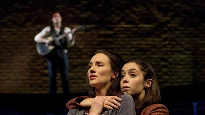 """In this theater image released by Boneau/Bryan-Brown, Elizabeth A. Davis, left, and Cristin Milioti are shown during a performance of the musical """"Once."""" After years of toil in regional theater and off-Broadway, Davis made her Broadway debut in March in the hit musical """"Once"""" and promptly earned her first Tony Award nomination. Davis was nominated for best featured actress in a musical.  The Tony Awards will be broadcast live on CBS on June 10. (AP Photo/Boneau/Bryan-Brown, Joan Marcus)"""