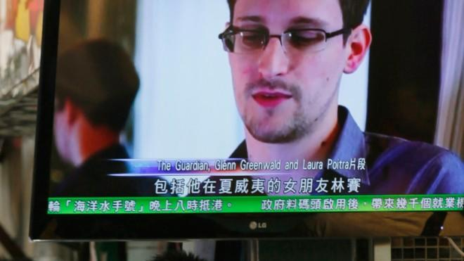 A TV screen in a Hong Kong restaurant shows a news report on Edward Snowden on June 12.