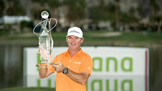 IMAGE DISTRIBUTED FOR HUMANA- 2013 Humana Challenge champion Brian Gay celebrates as he lifts the Bob Hope Memorial Trophy at PGA West on Jan. 20, 2013, in La Quinta, Calif.  Gay, who won the trophy in a playoff against Charles Howell III and David Lingmerth, shot 25 under par. The 2013 Humana Challenge was held January 14-20 at PGA West in La Quinta, Calif. (Rodrigo Pena / AP Images for Humana)