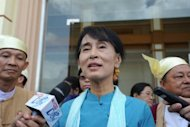Myanmar opposition leader Aung San Suu Kyi talks to the media as she leave the lower house of parliament in Naypyidaw in July 2012. Suu Kyi held talks with the country&#39;s president on Sunday in their first official meeting since she took up her role as a member of parliament