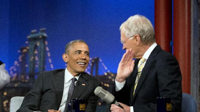"""President Barack Obama with host David Letterman talk during a break at a taping of CBS The Late Show with David Letterman at the Ed Sullivan Theater in New York, Monday, May 4, 2015. Obama traveled to New York to announced the creation of an independent nonprofit organization that is a spinoff his """"My Brother's Keeper"""" program, to tape a segment on Letterman's show and to do fundraising for the Democratic party. (AP Photo/Pablo Martinez Monsivais)"""