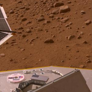 """This image provided by NASA shows a 2008 photo of a mini-DVD on the deck of the Phoenix lander on the Mars surface containing author Ray Bradbury's """"The Martian Chronicles"""" and other science fiction work. Bradbury died on June 6, 2012 at age 91. The mini-DVD from the Planetary Society contains a message to future Martian explorers, science fiction stories and art inspired by the Red Planet, and the names of more than a quarter million earthlings. (AP Photo/NASA)"""