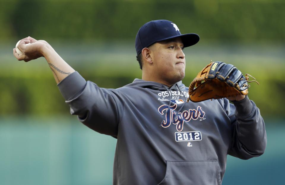 Detroit Tigers' Miguel Cabrera throws before the start of Game 3 of the American League championship series against the New York Yankees Tuesday, Oct. 16, 2012, in Detroit. (AP Photo/Paul Sancya )
