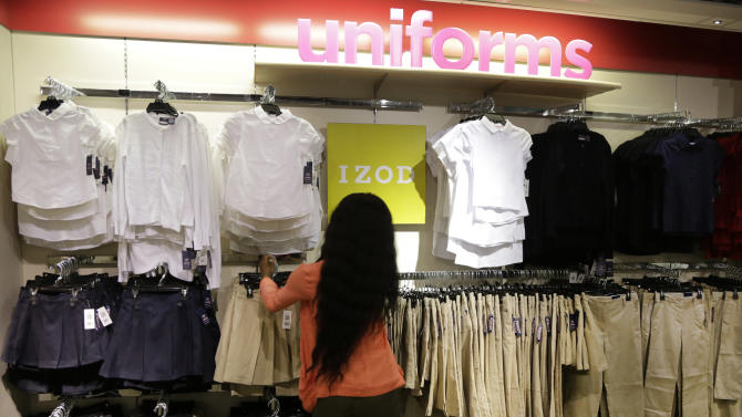FILE - In this July 31, 2013, file photo, school uniforms by Izod are displayed at J.C. Penney in New York. J.C. Penney reports quarterly financial results after the market closes on Wednesday, Feb. 26, 2014. (AP Photo/Mark Lennihan, File)