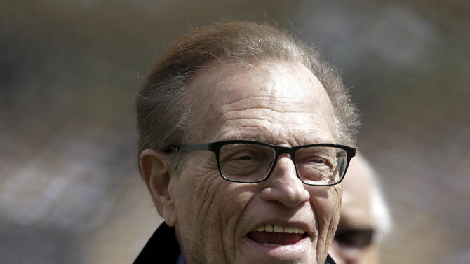 """This April 1, 2013 photo shows talk show host Larry King attending a season-opening baseball game between the Los Angeles Dodgers and the San Francisco Giants in Los Angeles.  King will host a political talk show beginning next month. The new program, """"Politics with Larry King,"""" will air on the RT America network, a global, English-language channel based in Russia, the network announced Wednesday, May 29, 2013. No premiere date was specified. (AP Photo/Jae C. Hong)"""