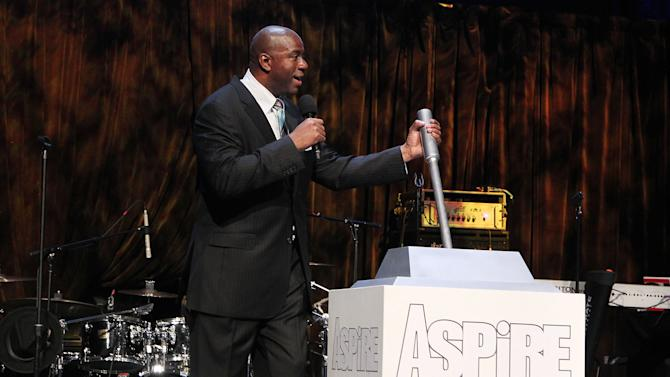 """This June 27, 2012 photo released by Starpix shows former NBA basketball player Earvin """"Magic"""" Johnson during the launch of the Aspire Television Network  in New York. Aspire, which signed on during the ceremony, is led by Johnson in partnership with family-oriented channel GMC TV, and will dedicate itself to enlightening and positive programming aimed at black families. It will air movies, documentaries, music and comedy, as well as faith and inspirational programs. (AP Photo/Starpix, Amanda Schwab)"""