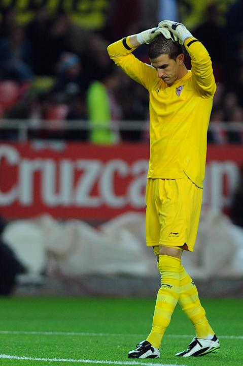 Sevilla's goalkeeper Javi Varas reacts during their Spanish league football match Sevilla FC vs Real Madrid on December 17, 2011 at Ramon Sanchez Pizjuan stadium in Sevilla. Real Madrid won 6-2.   AFP