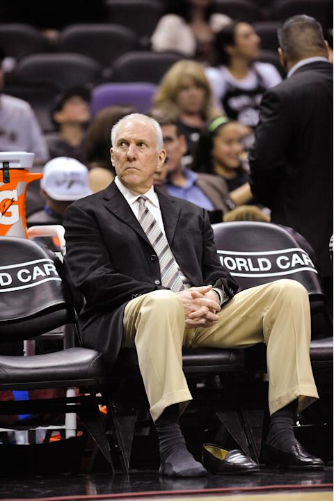 San Antonio Spurs coach Gregg Popovich waits on the bench prior to the second half of an NBA basketball game against the Los Angeles Lakers on Friday, March 14, 2014 in San Antonio