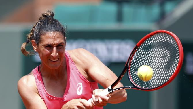 Virginie Razzano of France plays a shot to Veronica Cepede Royg of Paraguay during their women's singles match at the French Open tennis tournament at the Roland Garros stadium in Paris