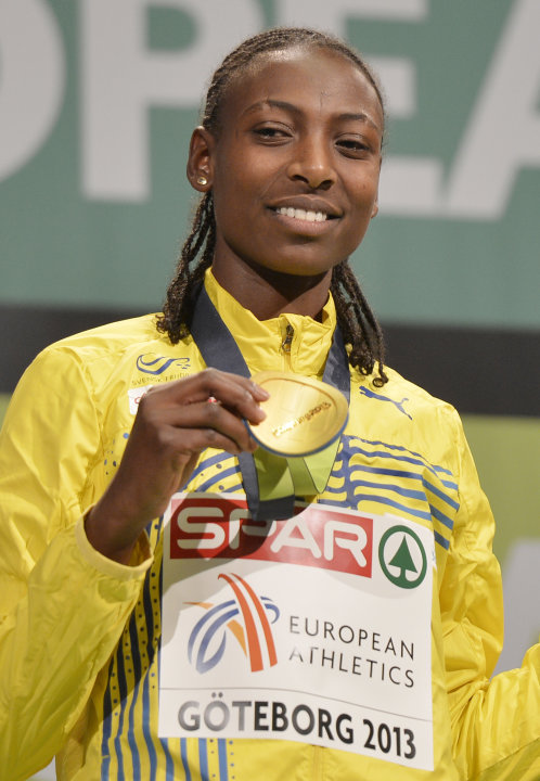 Sweden's gold medal winner Abeba Aregawi shows off her medal during the medal ceremony for the women's 1500m at  the Athletics Indoors European Championships in Gothenburg, Sweden, Saturday, March 2,