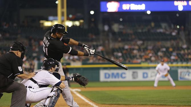 During the ninth inning in Detroit, Chicago White Sox's Alex Rios connects for his sixth hit to tie an American League mark with six hits in a nine-inning game during a baseball game against the Detroit Tigers, Tuesday, July 9, 2013. (AP Photo/Carlos Osorio)