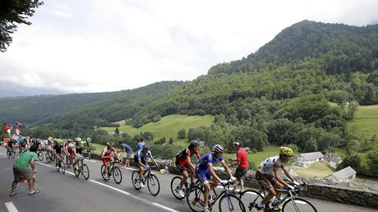 The pack of riders including race leader Astana team rider Nibali of Italy cycles during the 145.5km 18th stage of the Tour de France cycling race