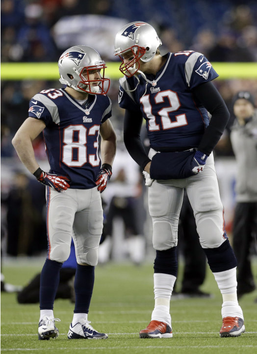 FILE - In this Jan. 20, 2013, file photo, New England Patriots quarterback Tom Brady (12) talks to wide receiver Wes Welker (83) before the NFL football AFC Championship football game against the Balt