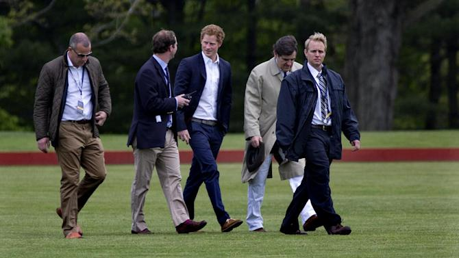 Britain's Prince Harry walks across the polo field before the Sentebale Royal Salute Polo Cup charity match in Greenwich, Conn., Wednesday, May15, 2013. Prince Harry is  is competing at the Greenwich Polo Club to benefit Sentebale, the charity he co-founded to help poor children and AIDS orphans in the small African nation of Lesotho.  (AP Photo/Craig Ruttle)