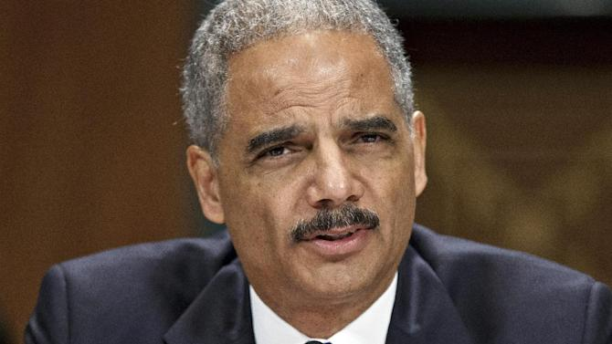 FILE - In this June 12, 2012, file photo, Attorney General Eric Holder appears before the Senate Judiciary Committee on Capitol Hill in Washington. Maybe there's a smoking gun in the Republican-led investigations of the Obama administration, and President Barack Obama's pushback. But a large part of it could be what always goes on during a presidential campaign: political gamesmanship. It ranges from GOP contempt of Congress threats against Holder over documents linked to a failed gun-trafficking operation to Obama's waving a to-do list in the face of lawmakers. (AP Photo/J. Scott Applewhite, File)