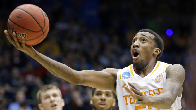 Vols rally to beat Iowa 78-65 in OT at First Four