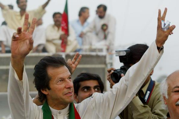 SHADI KHAL, PAKISTAN - OCTOBER 8:  Imran Khan, cricket captain turned politician and chairman of the Dhirir Tehrik-e-Insaf political party, waves to supporters during a rally October 8, 2002 in Shadi