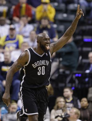 Brooklyn Nets forward Reggie Evans celebrates a tip-in basket in the final 45 seconds of overtime against the Indiana Pacers in an NBA basketball game in Indianapolis, Monday, Feb. 11, 2013. The Nets defeated the Pacers 89-84 in overtime. (AP Photo/Michael Conroy)
