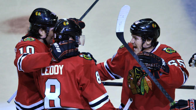Blackhawks beat Blues 4-0 behind Crawford